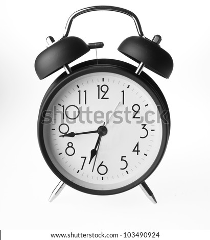 Old-fashioned alarm clock isolated on a white background