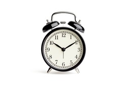 old fashioned alarm clock on white backgrounds.