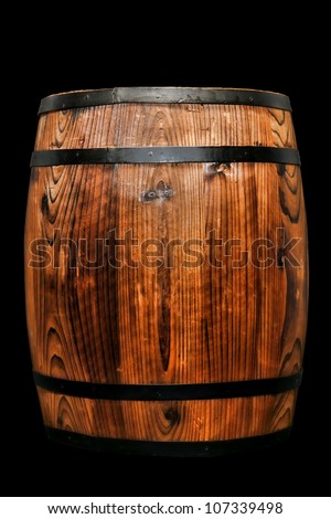 Old fashioned antique wood whisky barrel or vintage wine keg rustic container isolated on pure black background