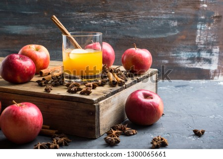 Old fashioned apple beverage on the rustic background. Selective focus.
