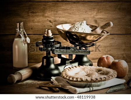 Old fashioned apple pie dessert with antique weighing scales