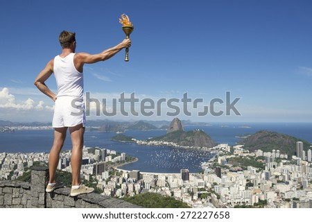 Old-fashioned athlete in classic vintage white sports uniform standing holding sport torch at city skyline overlook in Rio de Janeiro Brazil