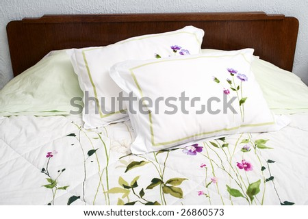 Old fashioned bed with floral bedding