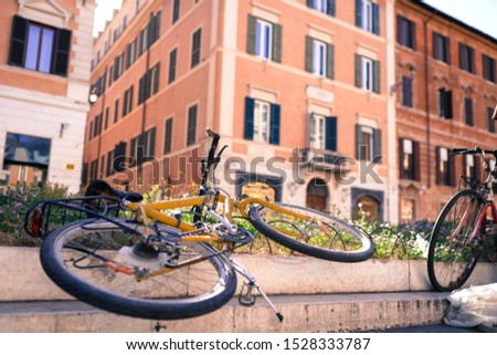 Old-fashioned bicycles on ancient italian streets,retro style photo. Amazing building and landmark, Roman architecture