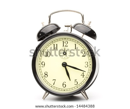 Old-fashioned black alarm clock  on a white background