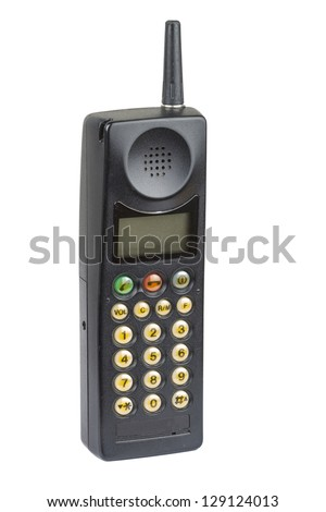 Old fashioned black mobile phone on plain background