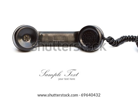 Old-fashioned black telephone receiver with cord on white background.