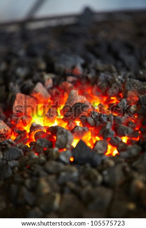 Old-fashioned blacksmith furnace with burning coals