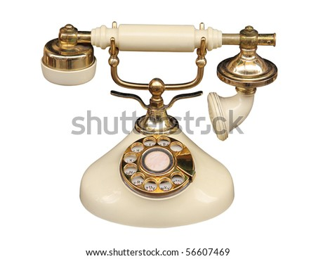 Old fashioned bone coloured telephone.