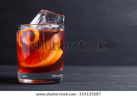 Old fashioned cocktail on the wooden background
