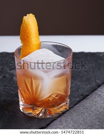 Old fashioned cocktail - whisky, sugar and bitters. A classic
