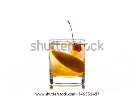 Old fashioned cocktail with cherry and orange peel #346351487