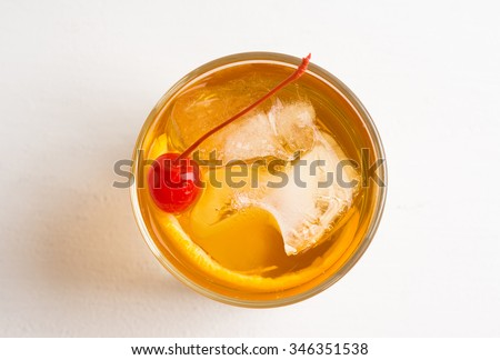 Old fashioned cocktail with cherry and orange peel #346351538