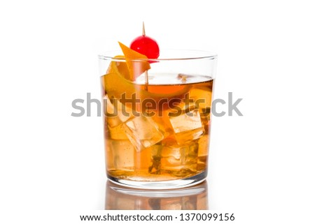 Old fashioned cocktail with orange and cherry isolated on white background.
