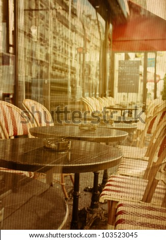 old-fashioned coffee terrace with tables and chairs,paris France - stock photo