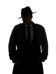 Old fashioned detective in hat on white background