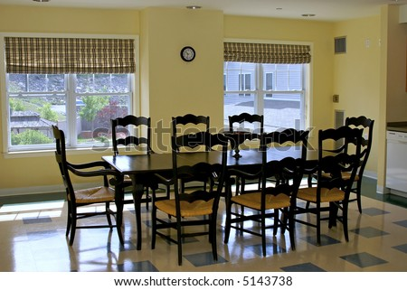 Old fashioned dining table in yellow room with windows for Old fashioned dining room tables
