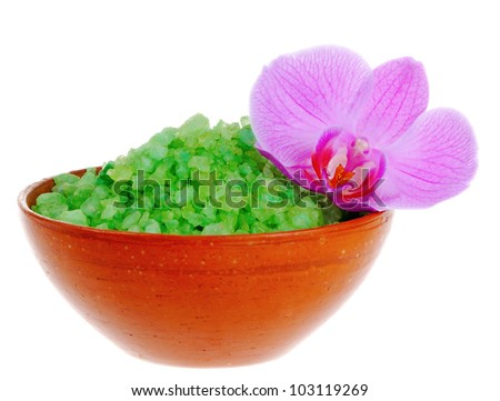 Old-fashioned dish with salt for bath and orchid flower on white background