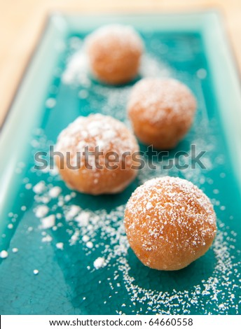 Old-Fashioned Doughnuts Sprinkled with Powder Sugar