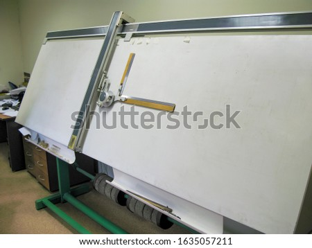 Old-fashioned drawing board for long drawings. Stock photo ©