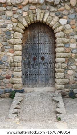 Old-fashioned entrance of the stone building