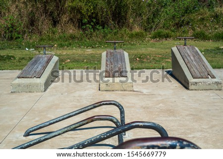 Old-fashioned exercise boards for sit-ups at Itaipava Municipal Park in Petropolis, Rio de Janeiro, Brazil