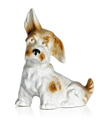 Old-fashioned figurine of a dog isolated on white