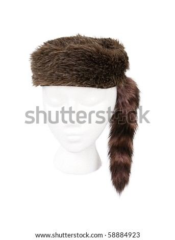 Old fashioned fur hunting hat isolated on white and resting on a model head for proper perspective