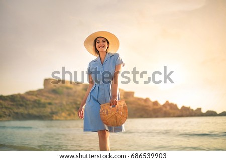 Old fashioned girl walking in the beach