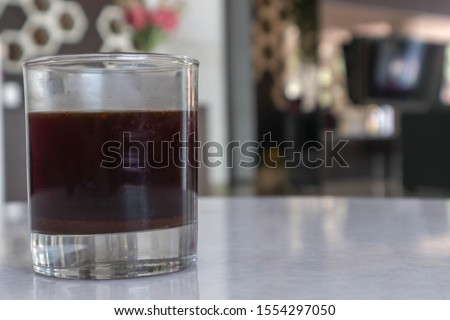 old fashioned glass of black coffee in the hotel and cafe in the afternoon and evening - segelas kopi hitam  di hotel dan cafe pada sore dan malam hari