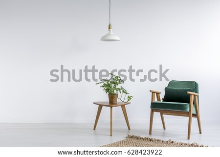 Old fashioned green armchair in white simple room #628423922