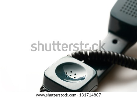Old-fashioned green telephone receiver