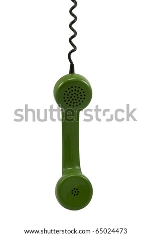Old-fashioned green telephone receiver with cord on white background