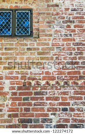 Old fashioned house exterior with weathered rough surface on the wall
