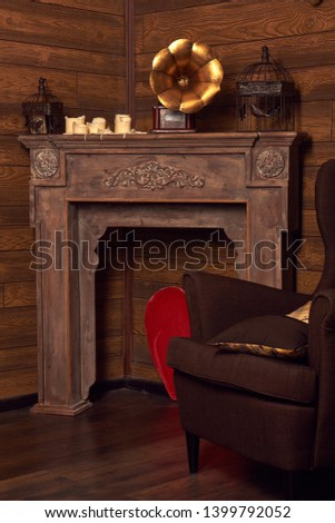 Old-fashioned interior with armchair. Domestic Room, Fireplace.