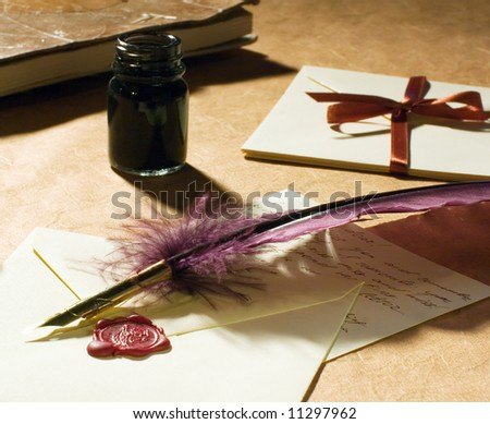 old-fashioned letters with a quill, an inkwell  on a rustic paper.
