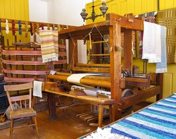 Old fashioned loom in weaving shop in pioneer setting