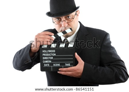 Old fashioned man holding movie clapboard