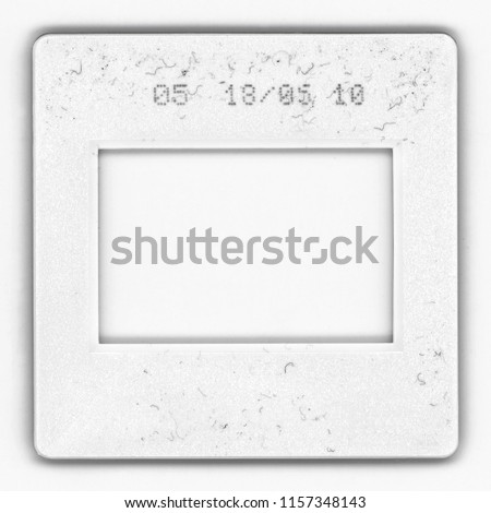 Old fashioned 35mm film frame with signs of usage, Real high-res 35mm photo dia slide scan isolated on white background.