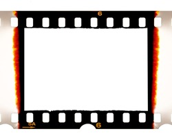 Old fashioned 35mm filmstrip or dia slide frame with burned edges isolated on white background. Real analog film scan with signs of usage.
