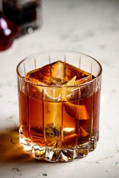 Old fashioned Negroni classic cocktail on counter bar background. Whisky Old Fashioned served on the rocks with orange zest
