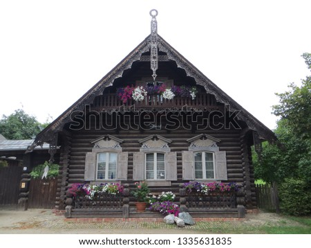 Old fashioned old wooden house #1335631835
