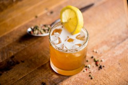 Old fashioned or Manhattan cocktail. Classic American drink with rye whiskey or bourbon, muddled maraschino cherries, oranges and sugar. Shaken, served over ice and garnished with an orange peel.