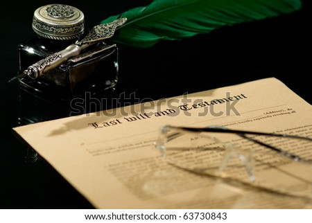 Old-fashioned paper with antique quill and text of Last will