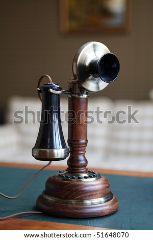 Old fashioned phone on the green table