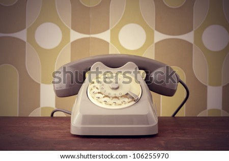 Old-fashioned phone on vintage background