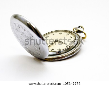 Old-fashioned pocket watch in the open state