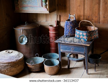 Old fashioned pots, pans and baskets of the 18th century in Skansen, Stockholm, Sweden
