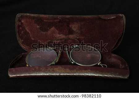 Old Fashioned Reading Glasses In Metal Case Stock Photo