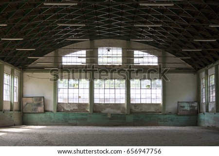 Old fashioned riding hall with sandy covering without people  #656947756
